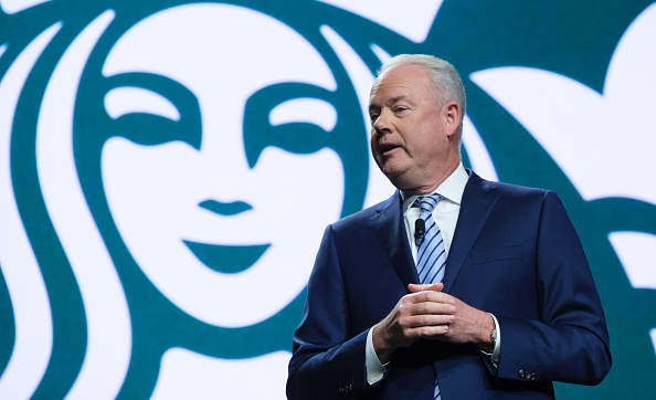 Starbucks shareholders vote against executive pay plan