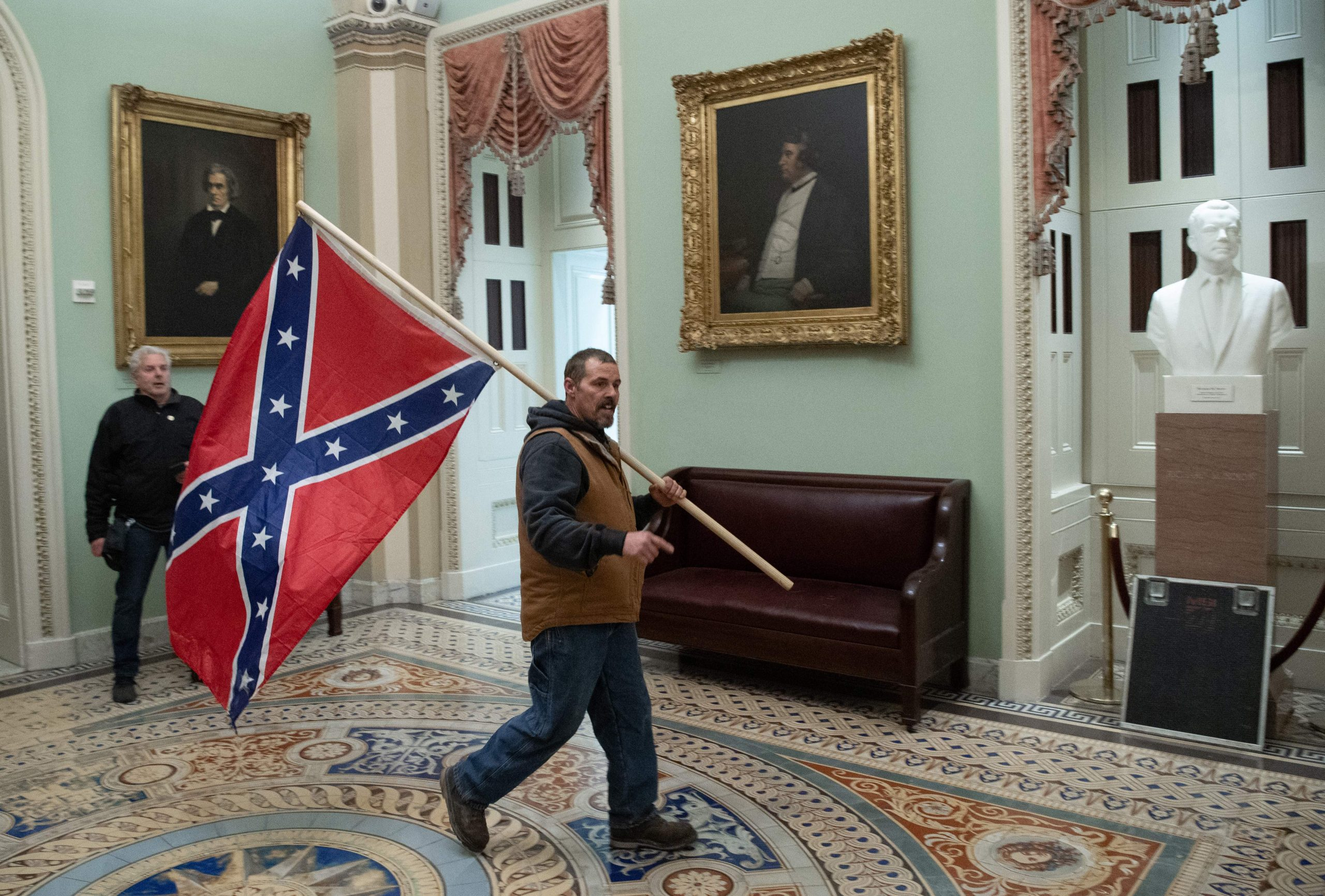Man who carried Confederate flag to Capitol during riot indicted