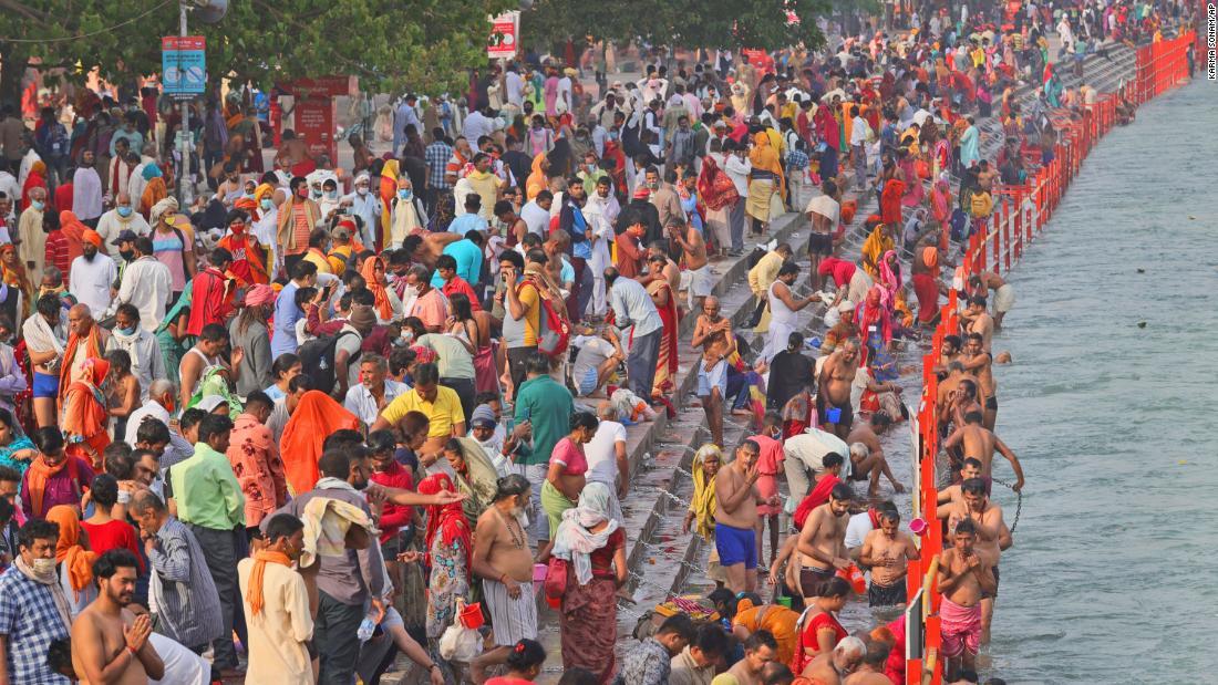 Kumbh Mela: Millions of pilgrims head to Haridwar, India, to dip in the Ganges River as coronavirus cases surge