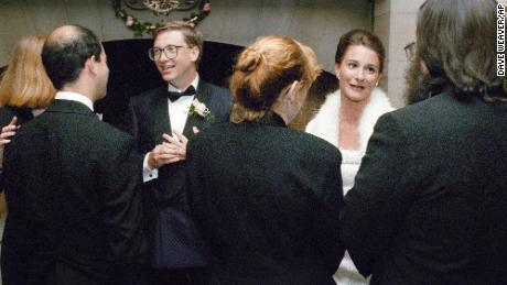 Bill Gates and Melinda French greet guests during a reception on Jan. 9, 1994 at a private estate in Seattle. The couple was married the week before in Hawaii.
