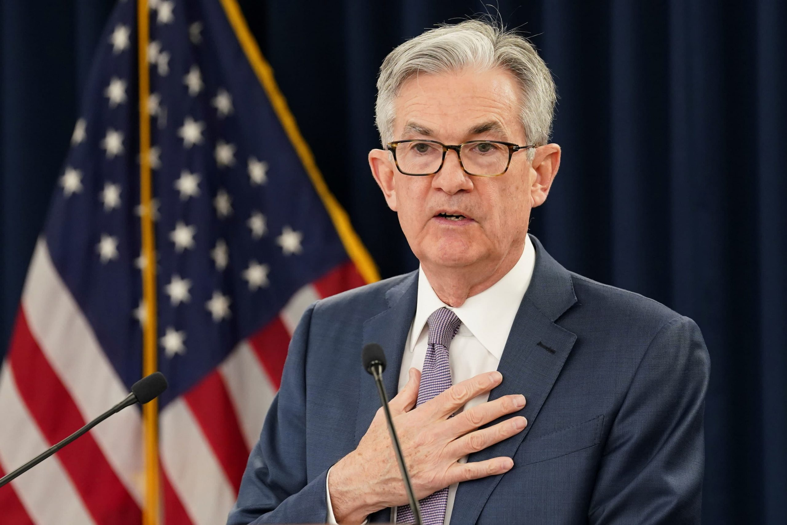 The Fed moves up its timeline for rate hikes as inflation rises