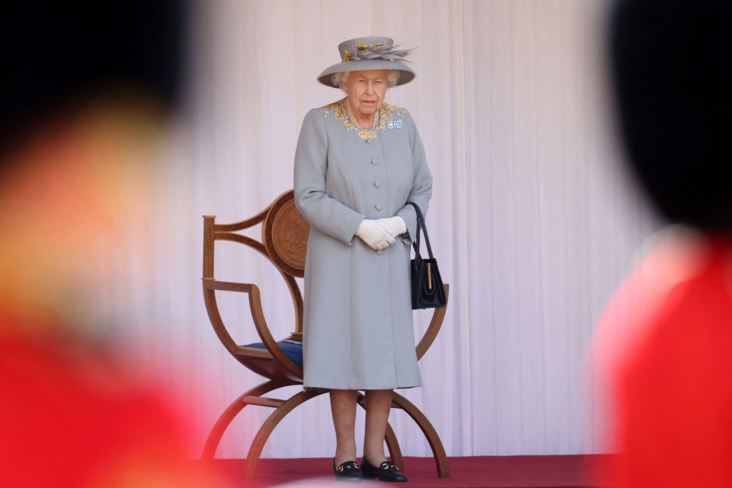 Queen Elizabeth II watches a military ceremony at Windsor Castle in England on June 12.