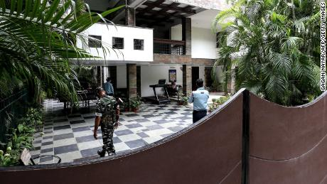 Security personnel at the Bhopal home of Sudhir Agrawal, managing director of Dainik Bhaskar. His residence was raided by Indian officials as part of a tax investigation.