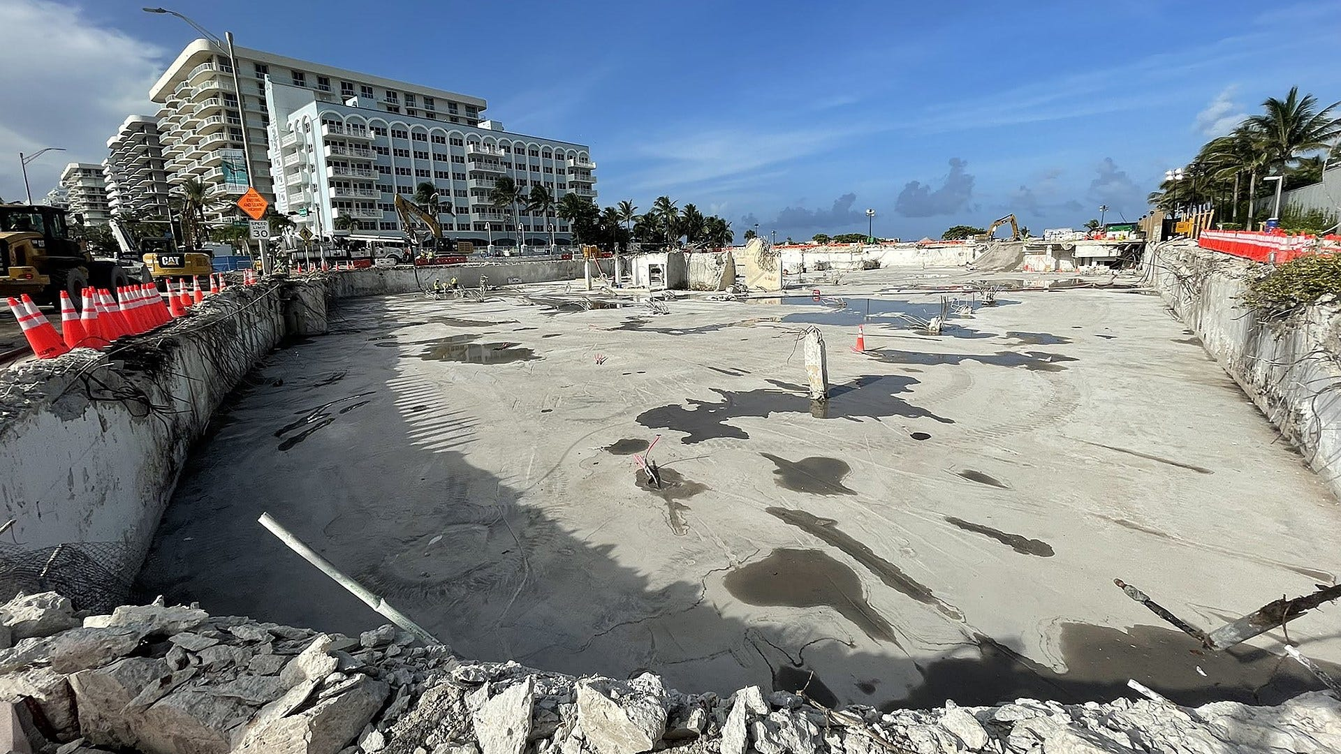 Towering pile of concrete and debris from Surfside condo collapse now a nearly empty pit - WRCBtv.com