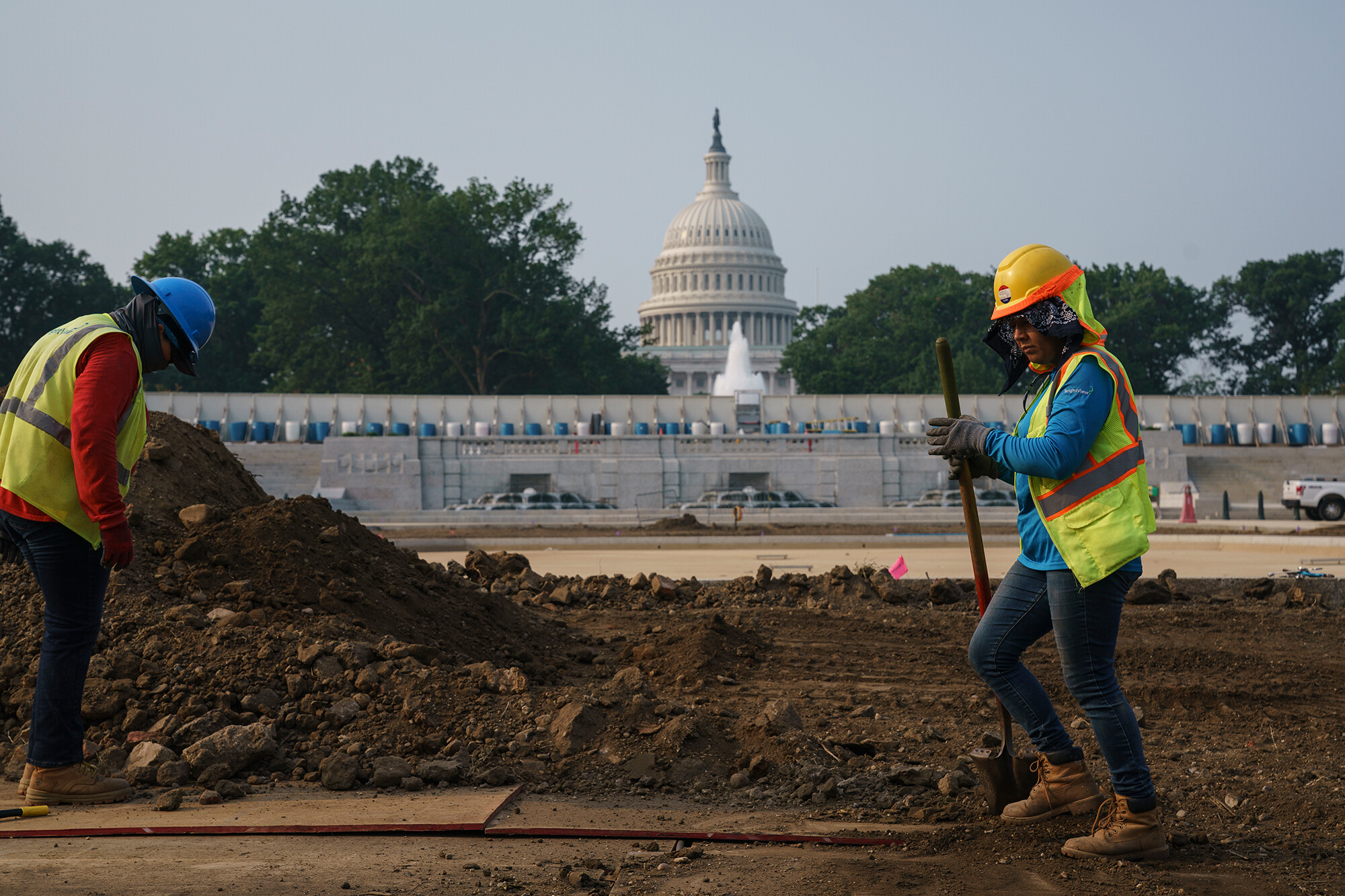 J. Scott Applewhite/APWorkers repair a park near the Capitol in Washington on July 21 as senators struggle to reach a compromise over how to pay for nearly $1 trillion in public works spending