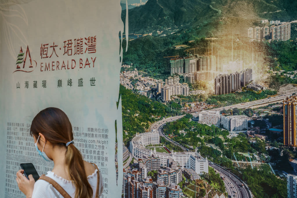 China Evergrande says property sales drop, warns it could default